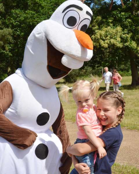 BIG TODDLE AT SANDRINGHAM'Sisters Taylah and Alyssa Moore meet Olaf, from the Disney film, Frozen