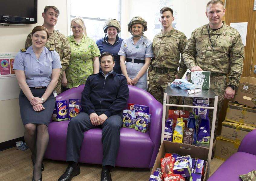 Officials from RAF Marham delivering Easter eggs to children in hospital