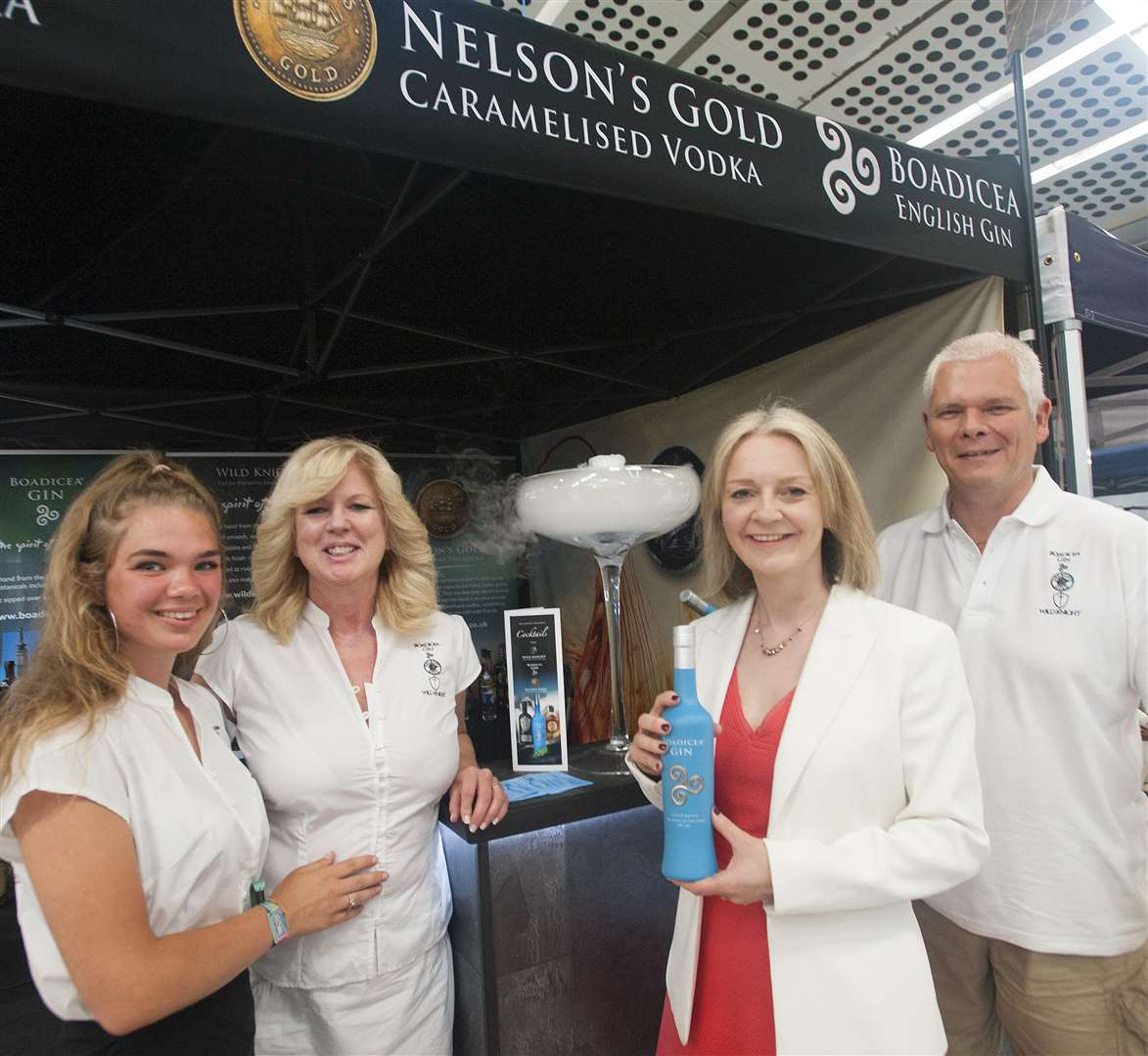 MP Elizabeth Truss at The Royal Norfolk Show Pictured with local Business Producing Nelson's Gold Vodka. Boadicea English Gin. FLtoR Katya Brown. Stephanie Brown. Elizabeth Truss (MP) Matt Brown.. (2788460)