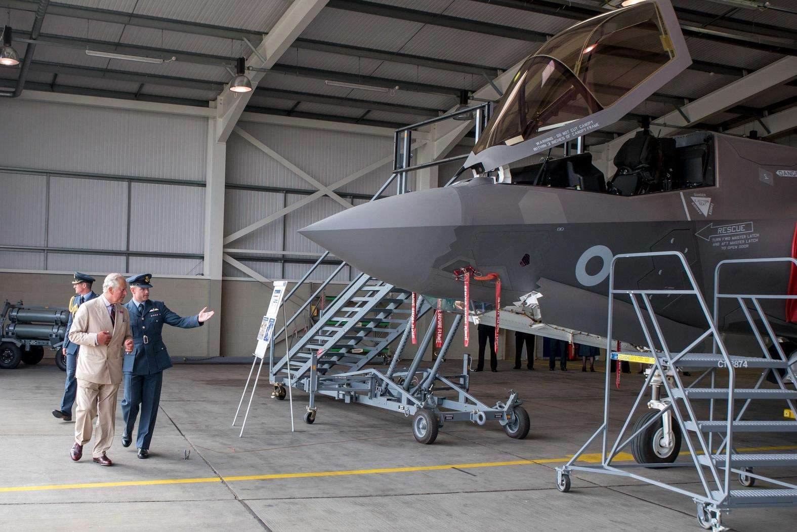 HRH The Prince of Wales visits RAF Marham to see the new F35 Lightning II aircraft of 617 Squadron. Wing Commander John Butcher shows HRH Prince Charles around the aircraft.. (3315070)