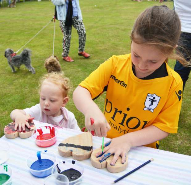 RUDHAMS FETE'One year old Talia Rasberry-Higgins and Ava Seppings, aged six, enjoyed messing about with paint as they decorated wooden plaques