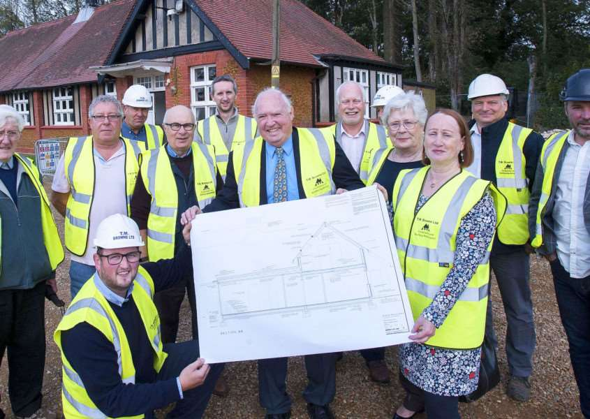 Building Work on new Dersingham Village Centre. Pictured in front Darren Browne (Managing Director) T.M.Browne, Cllr Chris Davey, Sue Payne (Chairman Parish Council) with New Drawing Plans.