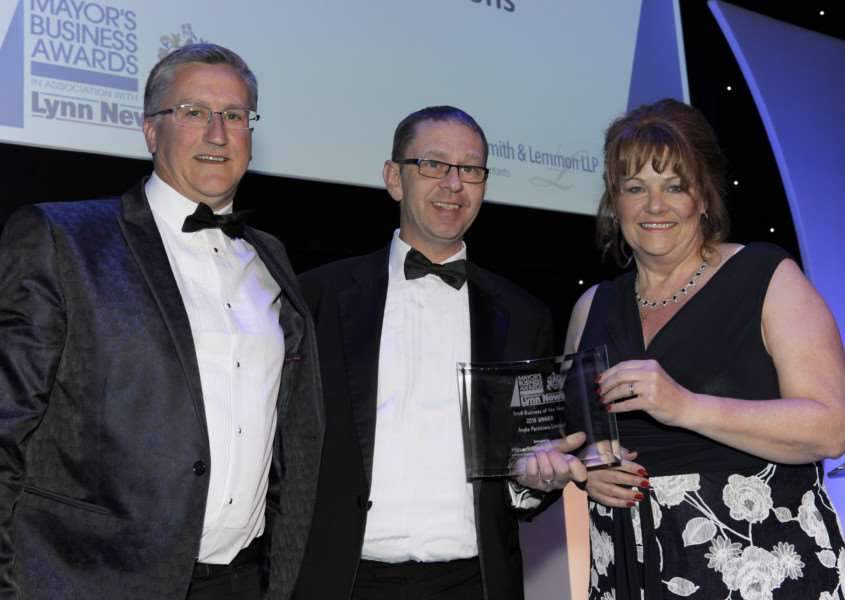 Small Business of The Year winner Anglia Partitions' Ian and Helen Swadling presented by Mapus Smith and Lemmon's Jason Hall