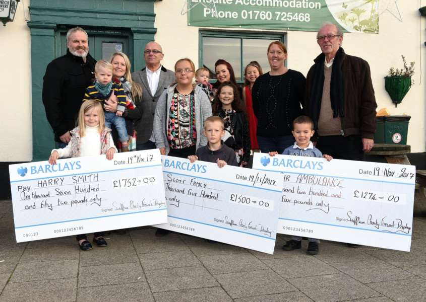 Swaffham Charity Firework Display cheque presentation to The Scott Family, Harry Smith and East Anglian Air Ambulance.