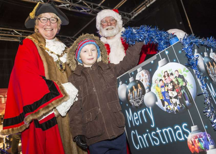 "Scenes from the King�""s Lynn Chirstman Lights Switch On 2017 - Thomas Paterson (8) lights up the Chrstmas lights, with Mayor Carol Bower and Father Christmas."
