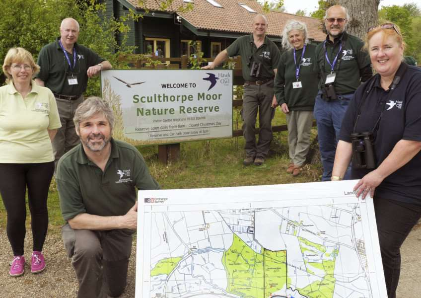 Sculthorpe Fen Land Purchase Appeal Launch at Sculthorpe Moor Community Nature Reserve Visitor Centre'Front LtoR, holding map of area, Nigel Middleton and Su Gough, with others involved at the Reserve