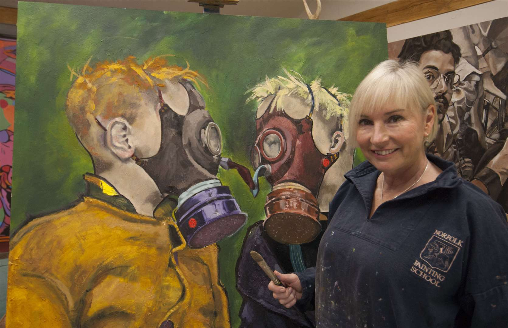 Terri Broughton with one of her paintings. Picture: SUBMITTED. (19834061)