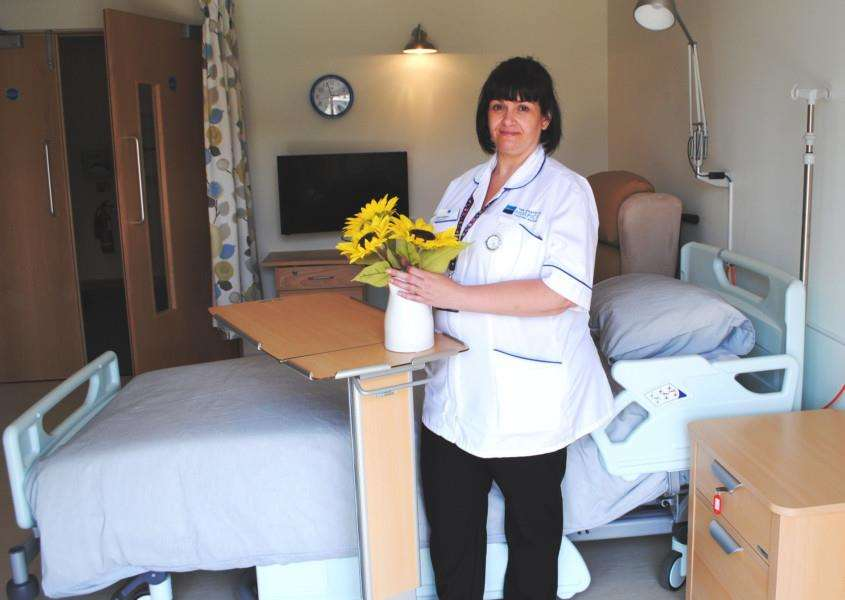 Hospice Nurse Clare Hargest preparing a room for the first patient