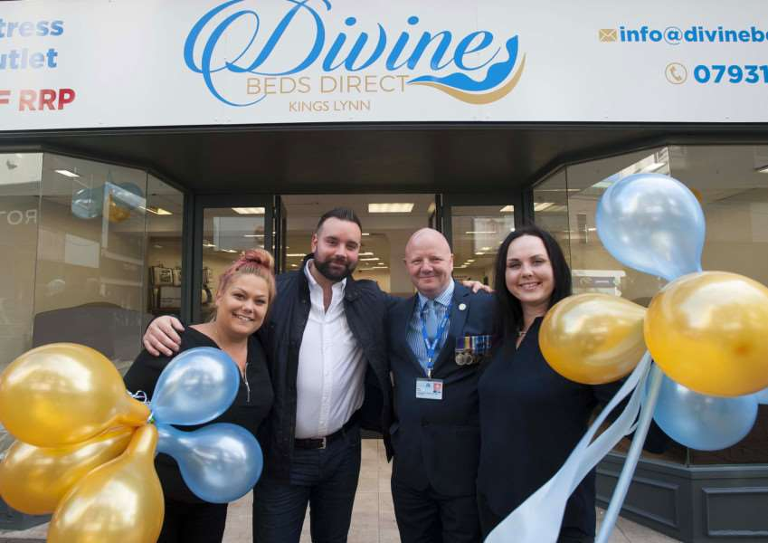 Official opening of new shop Divine Beds Direct. King's Lynn High street. Pictured FLtoR Alexandra Corhan. David Lyles (Owner) Cllr Mike Taylor. Velga Bondare.