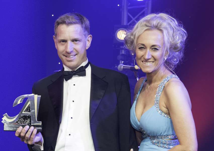 Director of Premier Travel Paul Waters collects the award from Lucy Huxley, editor of Travel Weekly.
