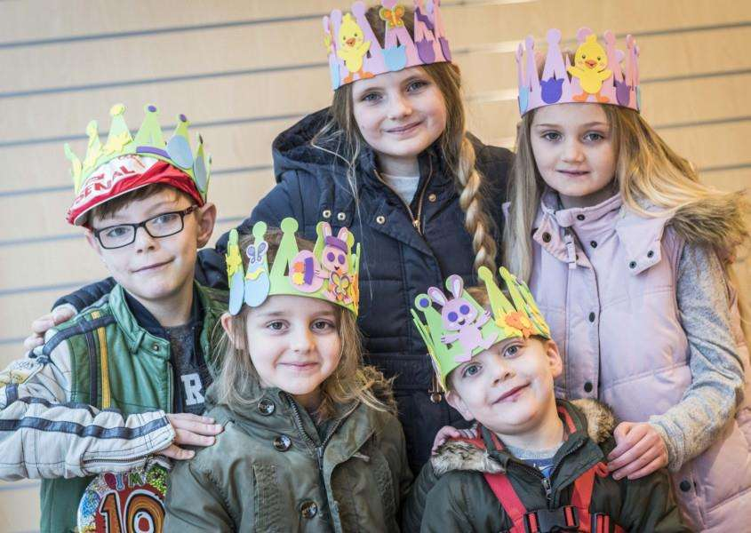 Youngsters show their completed crowns