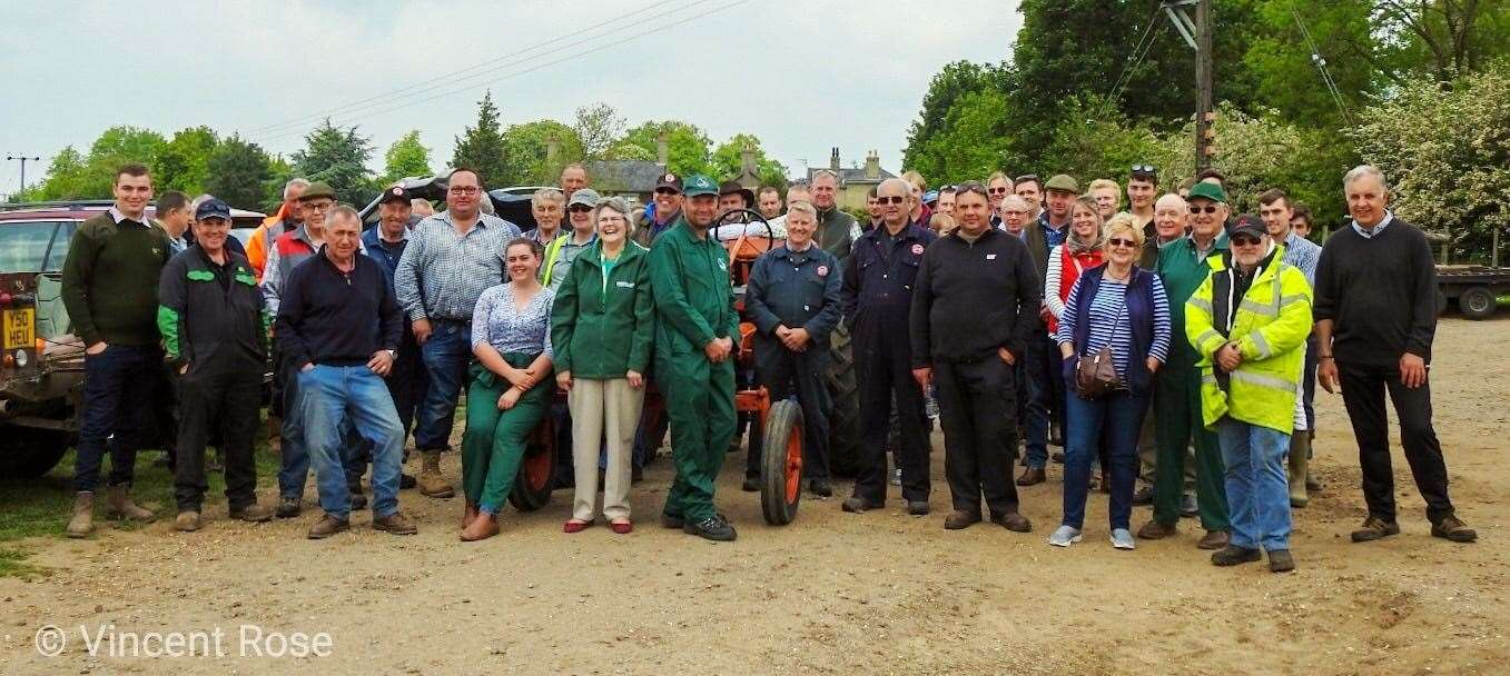 Methwold tractor run picture at Church Farm with local Macmillan chairwoman. (11453101)