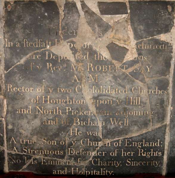 St Mary's, Houghton on the Hill' A stone smashed by Satanists who wanted to get at the bodies of previous rectors lying beneath