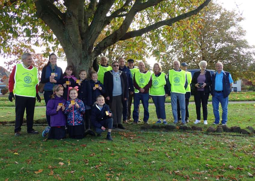 Downham Rotary Club join forces with students from Hillcrest Primary School and Nelson Academy to plant crocuses for Purple4Polio. Photo: SUBMITTED.