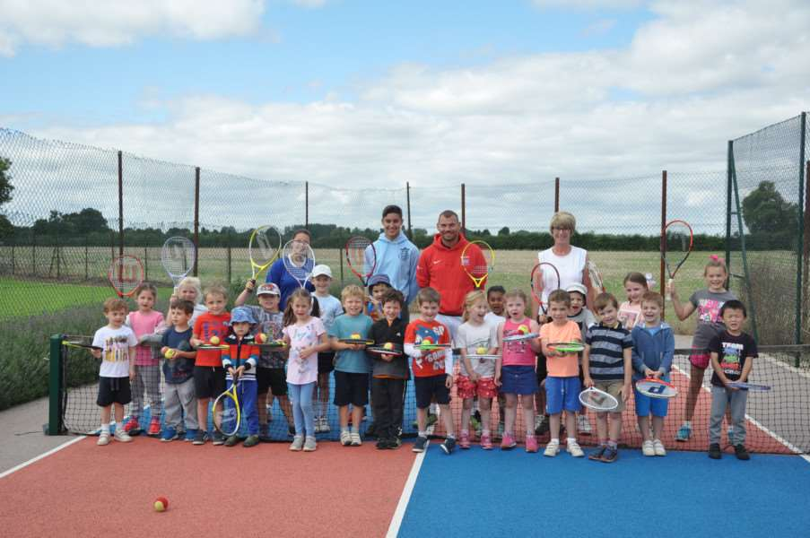 photo shows children who took part in the Holiday Activity on Thursday 10th August with Coach Glenn Perkins in red, assisted by Amy, George and Jane)