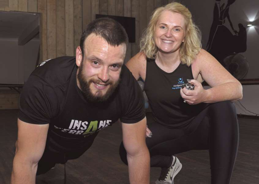 Fitness instructor Ross McConnachie doing around 6,000 burpees to raise money for Jac Coffey & family at West Lynn Social Club.'Ross McConnachie with Anna Hodgson