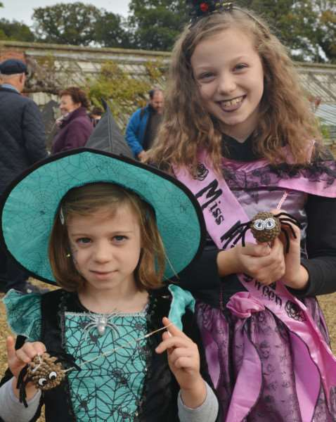 Holkham Halloween'Daisy and Esther Harrop with their spooky spiders