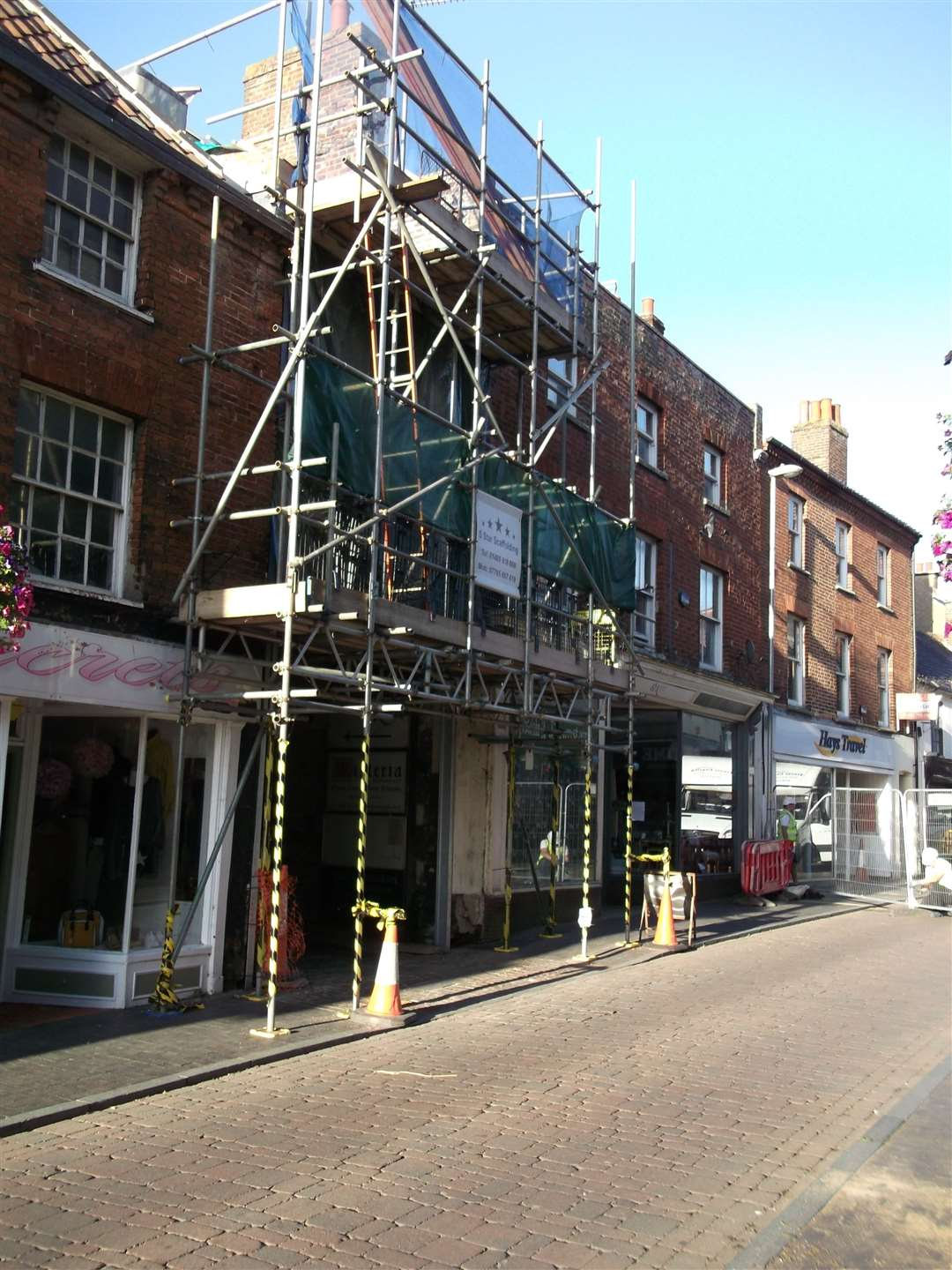 Norwich Street in Fakenham, which has been closed due to safety concerns over a dangerous building which is to the right of the scaffolding (16453808)