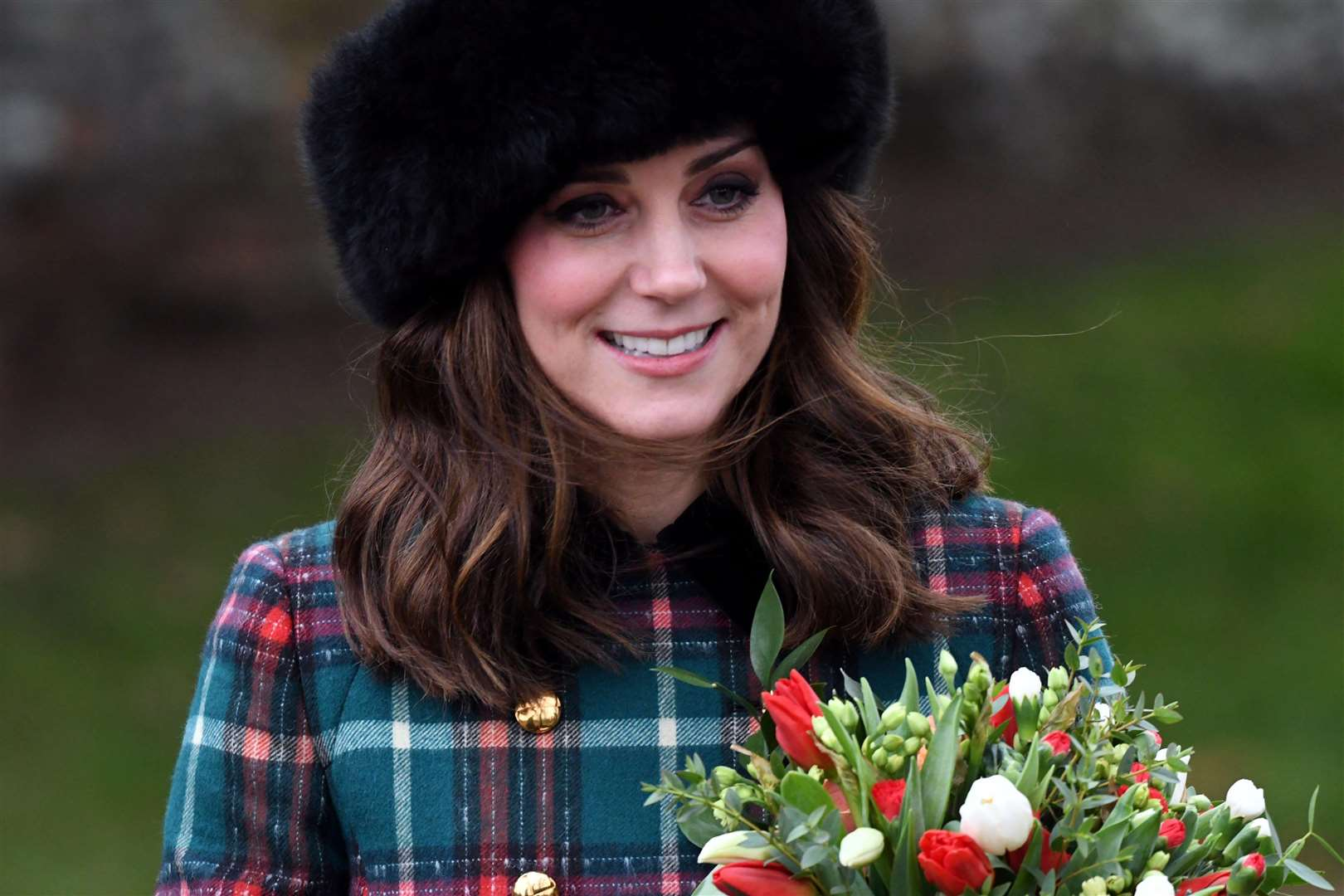 The royal 'fab four' are all smiles at annual Christmas church service