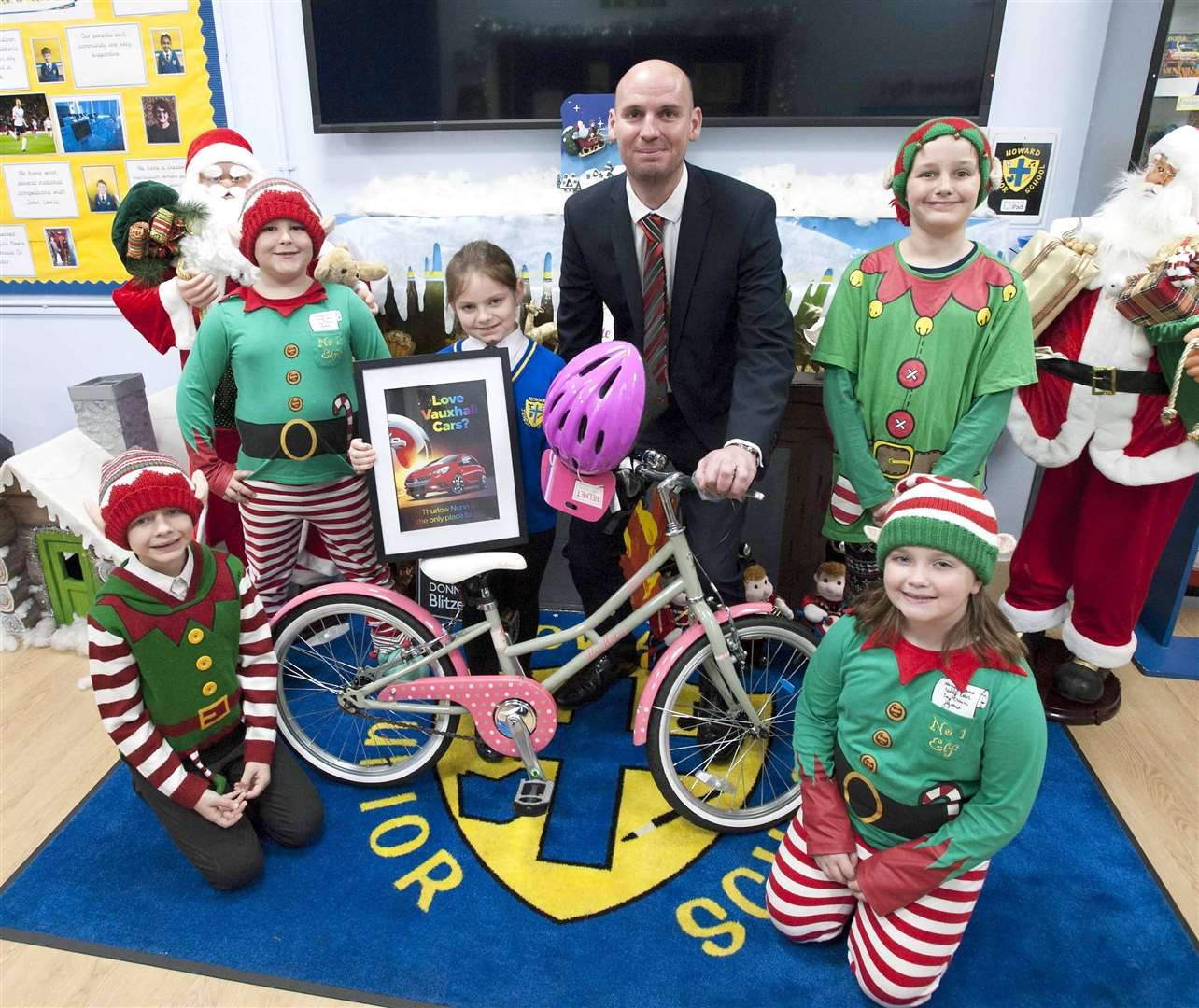 Howard Junior School King's Lynn. Pictured Elf's Zak Williams Katie Williams, Osmon Hastings, Daniel Wilson with pupil Victoria Drozdz, winner of the Vauxhall Poster Design and James Seayer (Vauxhall King's Lynn)