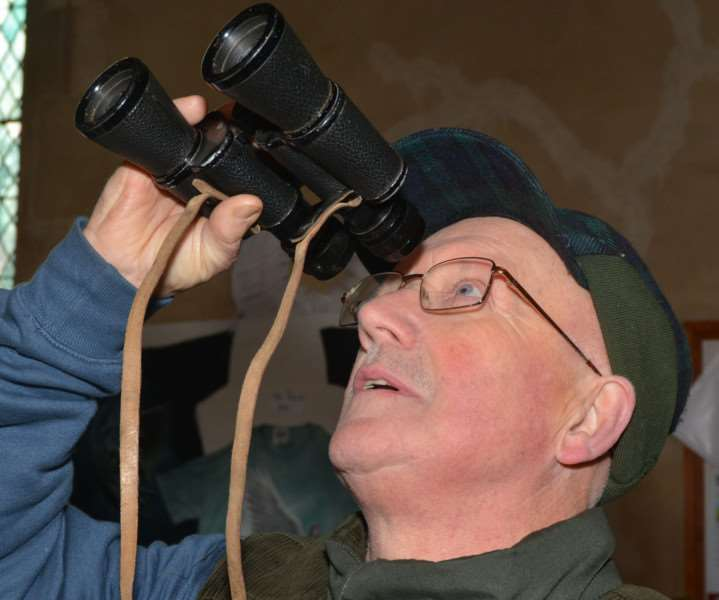 HARPLEY CHURCH ANGEL FESTIVAL'Parochial church council member David Mallow who, with the aid of binoculars and a strong spot light, helped visitors get a close-up view of the distant wooden angels which adorned the church roof