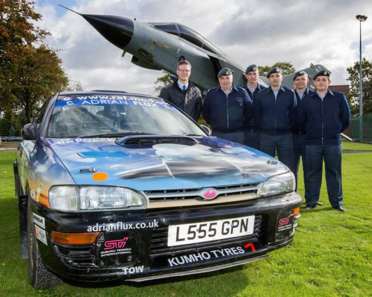 Adrian Flux pr images for the sponsorship on the RAF Typhoon Rally car. Posed in front of the RAF Marham gate guardTornado GR1 with a member from Adrian Flux Craig Darwin and RAF maembers (front row) CT Chris Daykin, Cpl Guy Bentley, SAC(T) James Hollis; Back Row SAC(T) Lewis Lawes, SAC(T) Ben Church.