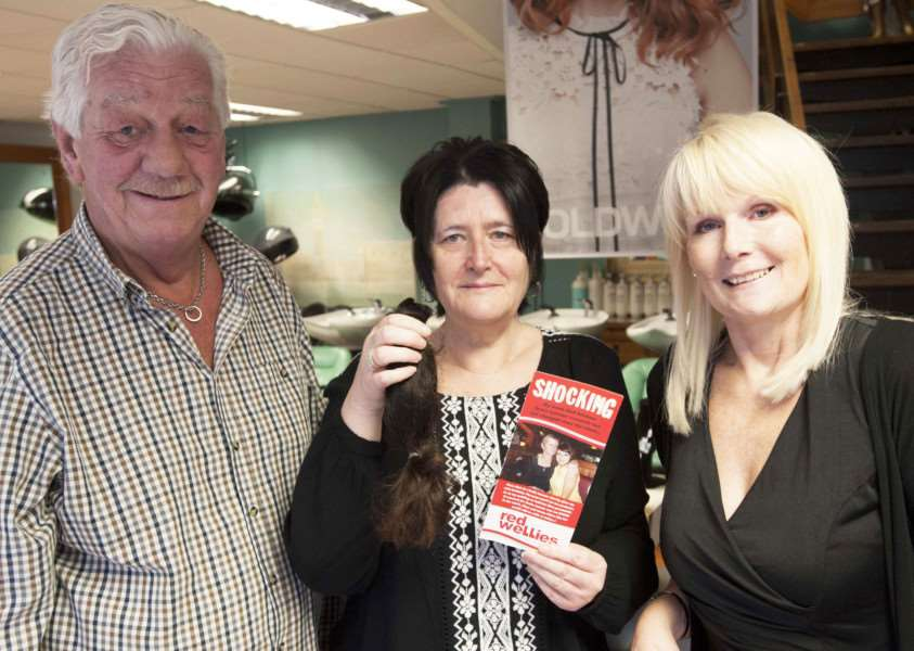 Haircut for Red Wellies Charity. Pictured FLtoR Mervyn Wiles(Red Wellies Charity) Jenny Jackman (After her haircut) Julie Keeling ( Owner Keeling Hairdressers )