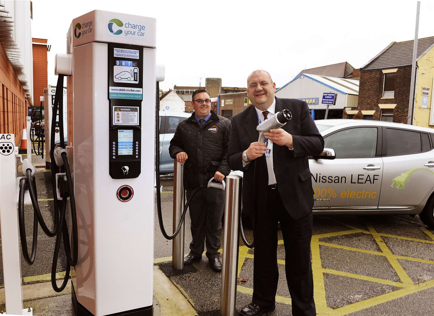 New Electric Car Charging Points at St James Car Park King's Lynn.Brian Long (Cabinet Member for Environment) launches the new facility, with Scott Walker (Nissan Sales Manager at West of King's Lynn.. (44570315)
