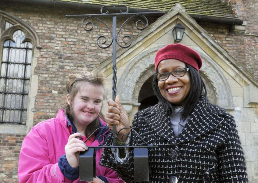 Churchill Park Students and staff have presented 40 candelabras they've restored for St Faith's Church Gaywood, our picture shows Rev Karlene Kerr with student Mia Aiken with one of the candelabras