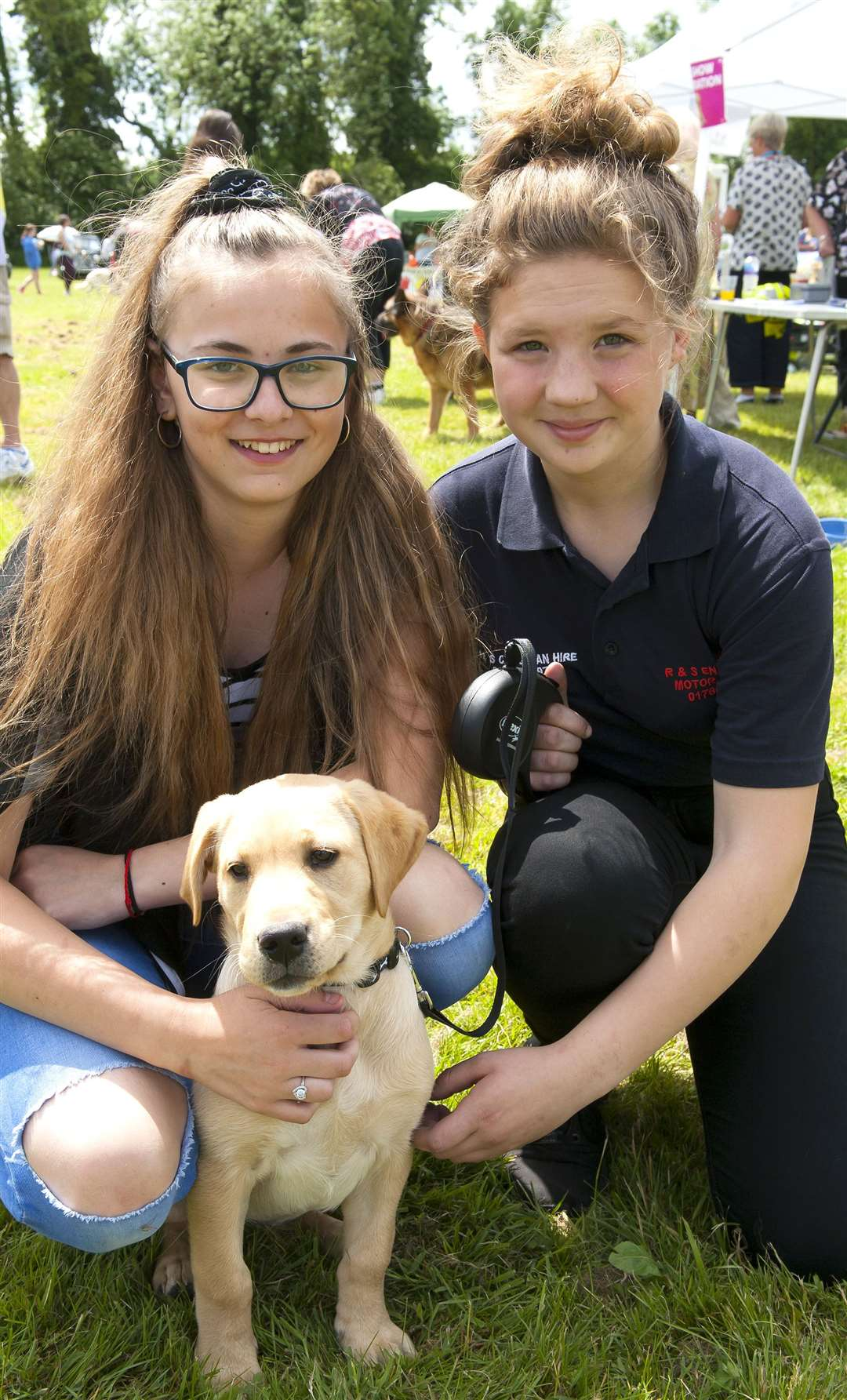 Aleah Baily and Emily Stowell with Stella,16-week old Labrador