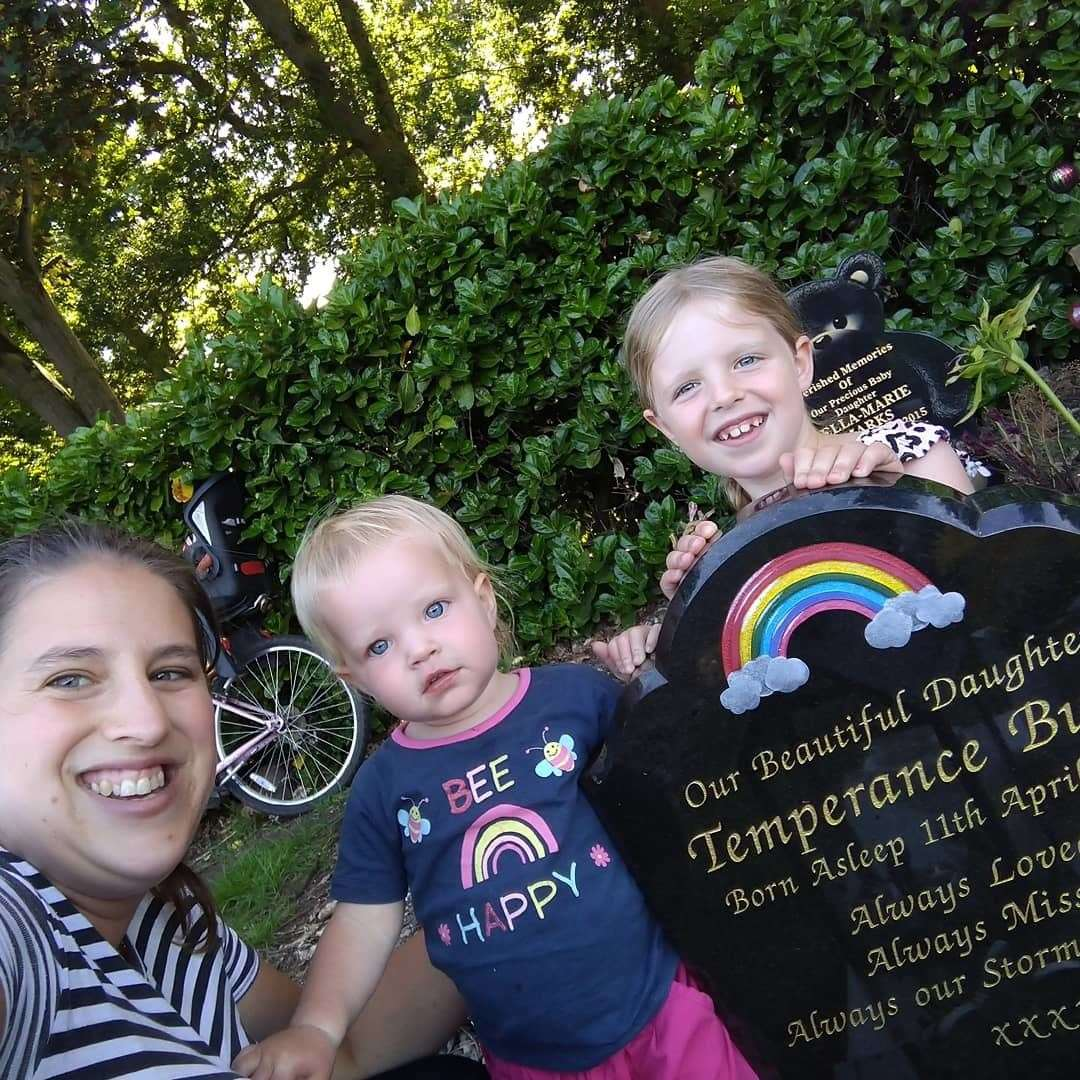 Alex Bush with her children Travis and Saffron at the grave of Temperance. Picture: SUBMITTED