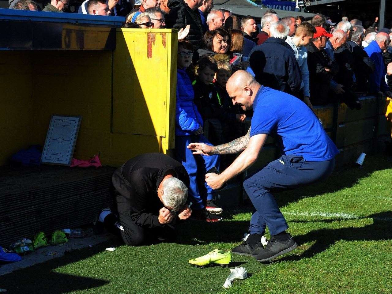Emotional King's Lynn Town manager Ian Culverhouse sinks to his knees after watching his side clinch promotion. Picture: Tim Smith. (10122979)