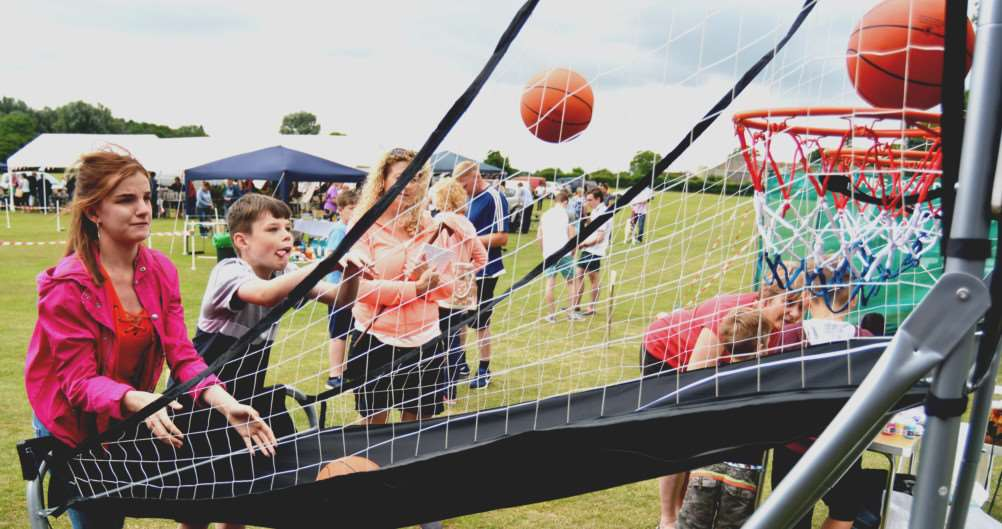RUDHAMS FETE'Chantelle and Connor Gosling try their hand at a basketball sideshow