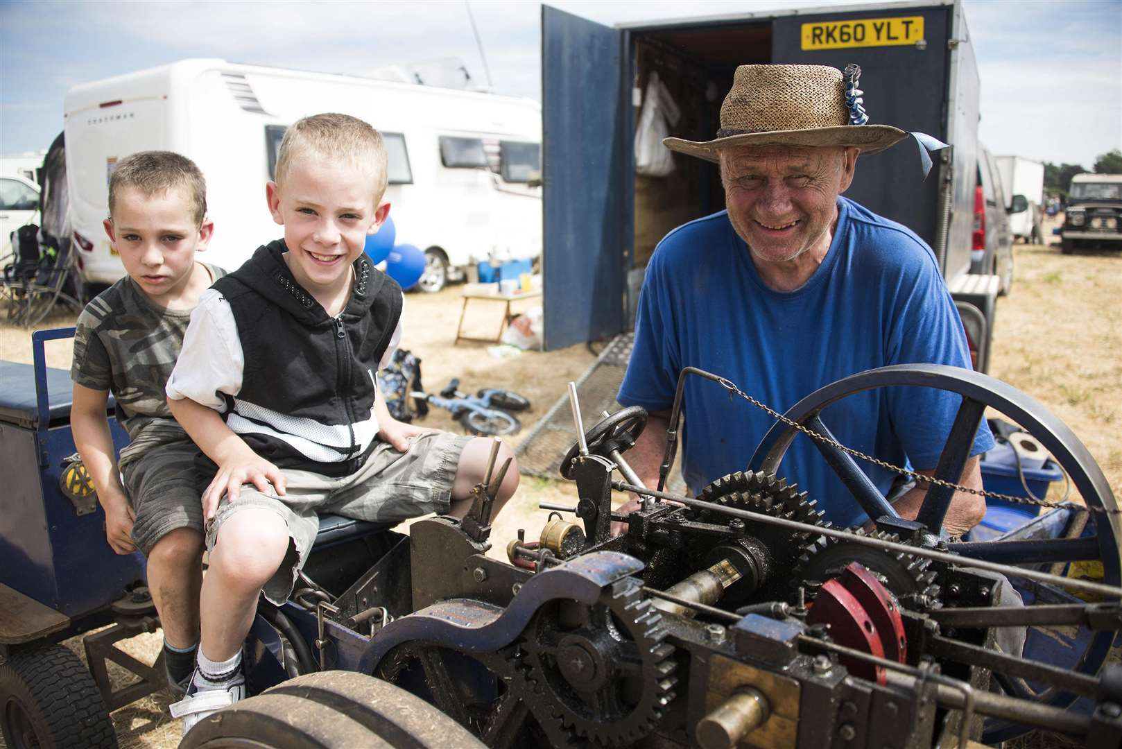 Weeting Steam Engine Rally and Country Show Luke and Aaron Reynolds aged 8 with Geoff Miles Picture Mark Westley. (3196212)