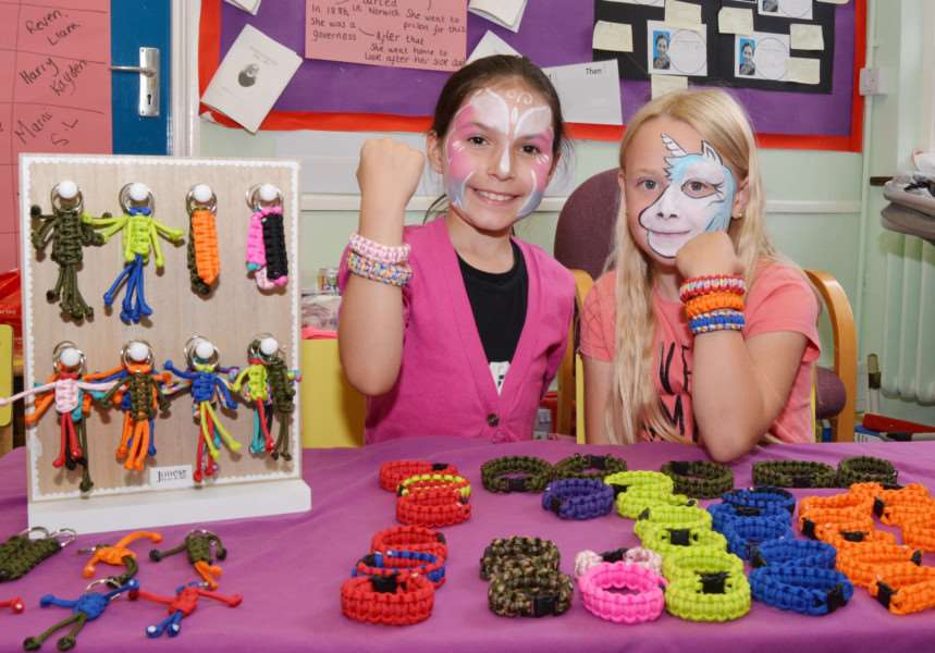 HEACHAM INFANT SCHOOL SUMMER FETE'Fashion accessories were offered for sale by Lauren Caunt, left, and Neve Tuddenham