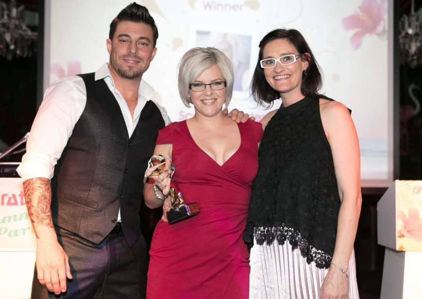 Scarlett Senter, centre, receives her award from Duncan James and Alex Fox, editor-in-chief of Scratch magazine