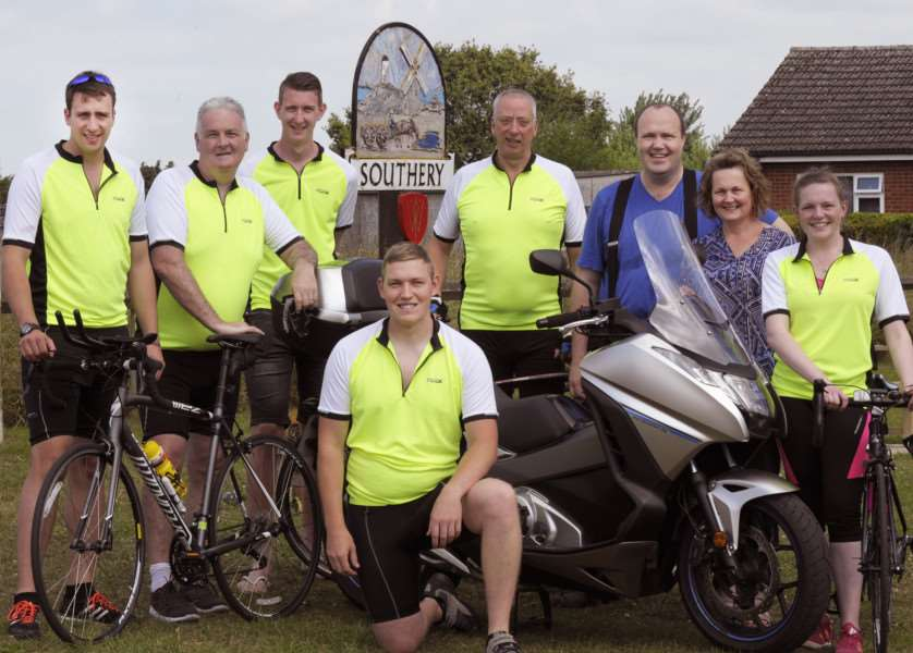 Mamilton (Middle Aged Men in Lycra Tour of Norfolk team) preparing for fundraising ride, Southery.'LtoR, James Dewing, Ray Mcallister, Courtney Pettifor, Spike Dewing, David Fletcher, Jane Taggart, Katie Taggart and Chris Jones (front)