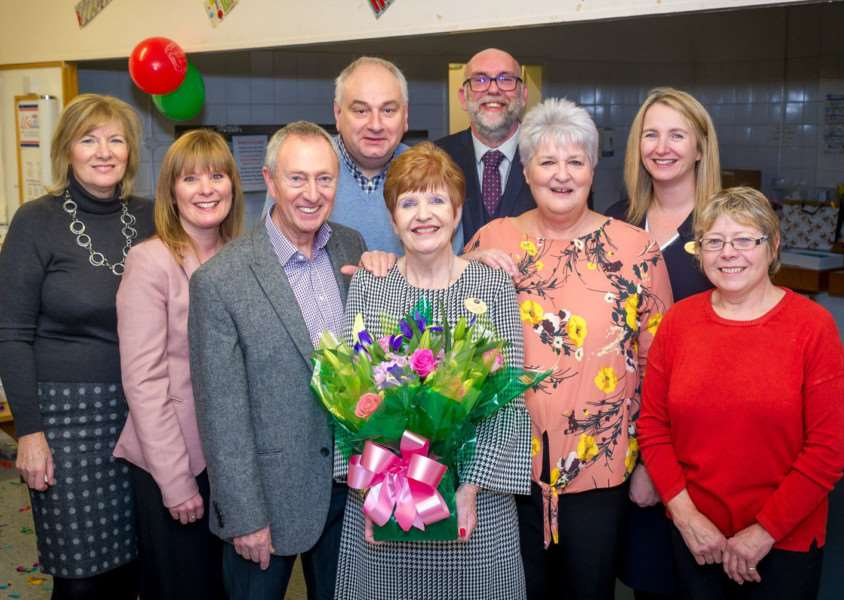 Julie Wittred (centre) on her last day at Boots after 49 years with LtoR, current and past members of management, Cynthia Reeve, Sarah Hayes, Eric Fairbrother, Dave Chapman, Dave Gunner, Ruth Smith, Kay Watkinson and Anne Carnell