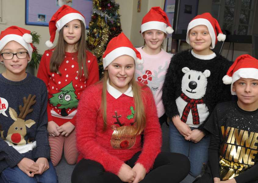 Middleton Church of England Primary Academy School Christmas Jumper Day and Santa Run Day iao EAST'Some of the pupils wearing Santa Jumpers and hats for the day