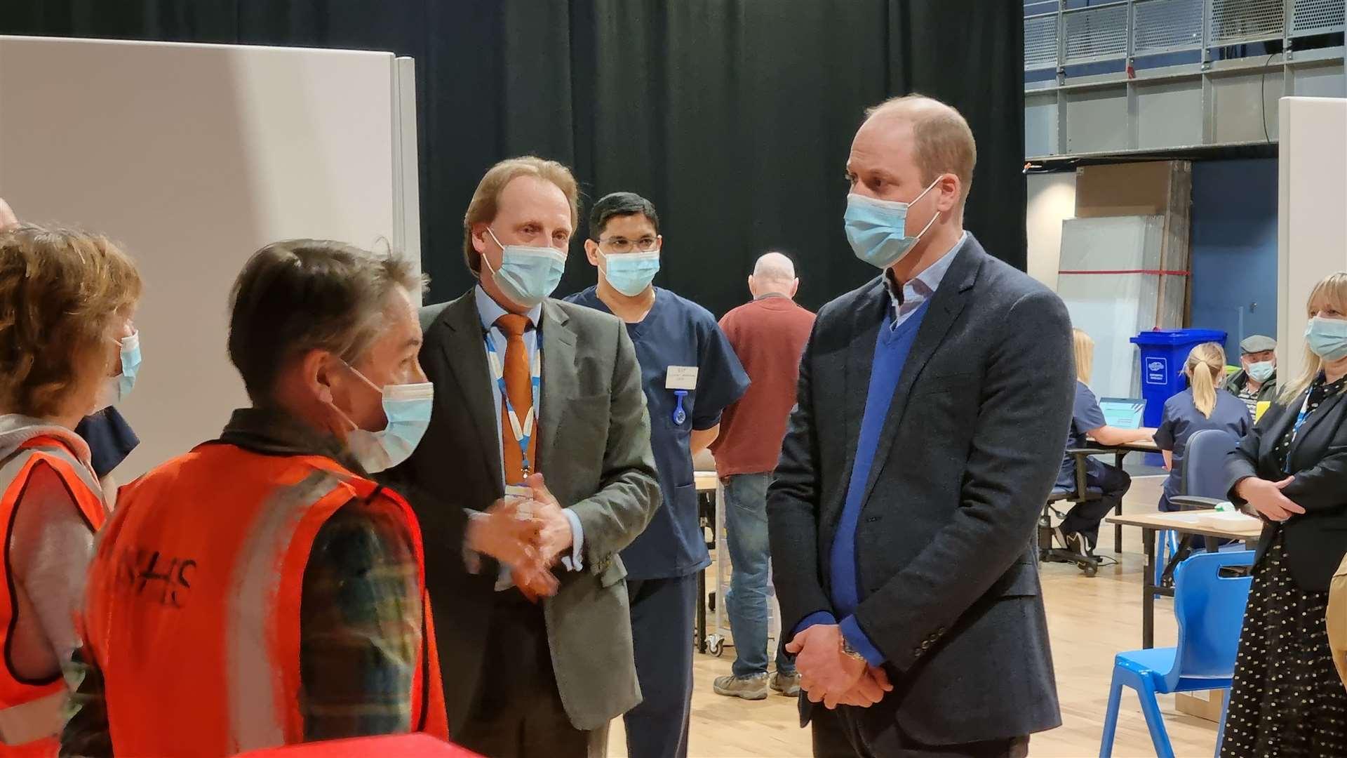 Volunteers Fliss and Stewart Davidson meet the Duke of Cambridge alongside CCS chief executive Matthew Winn (44524342)
