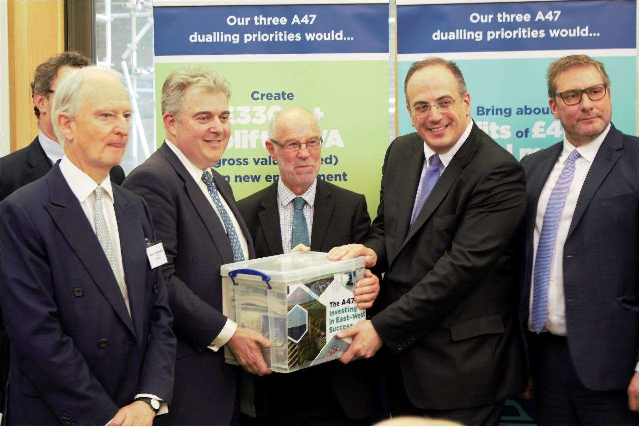 Minister of State for Transport Michael Ellis (second right) is presented with evidence gathered by the A47 Alliance, making the case for further dualling of the A47. Pictured left to right: Waveney MP Peter Aldous (partially obscured), West Norfolk MP Henry Bellingham, Great Yarmouth MP Brandon Lewis, Chairman of the A47 Alliance Martin Wilby, Michael Ellis and Mayor of Peterborough and Cambridgeshire James Palmer. (12981625)