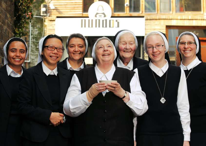 Catholic nuns from the Daughters of Divine Charity from Swaffham and Chesterfield convents serve soup to at 'NUNdos', a pop-up restaurant in London's Shoreditch, to launch the new Channel 5 series 'Bad Habits, Holy Orders'.