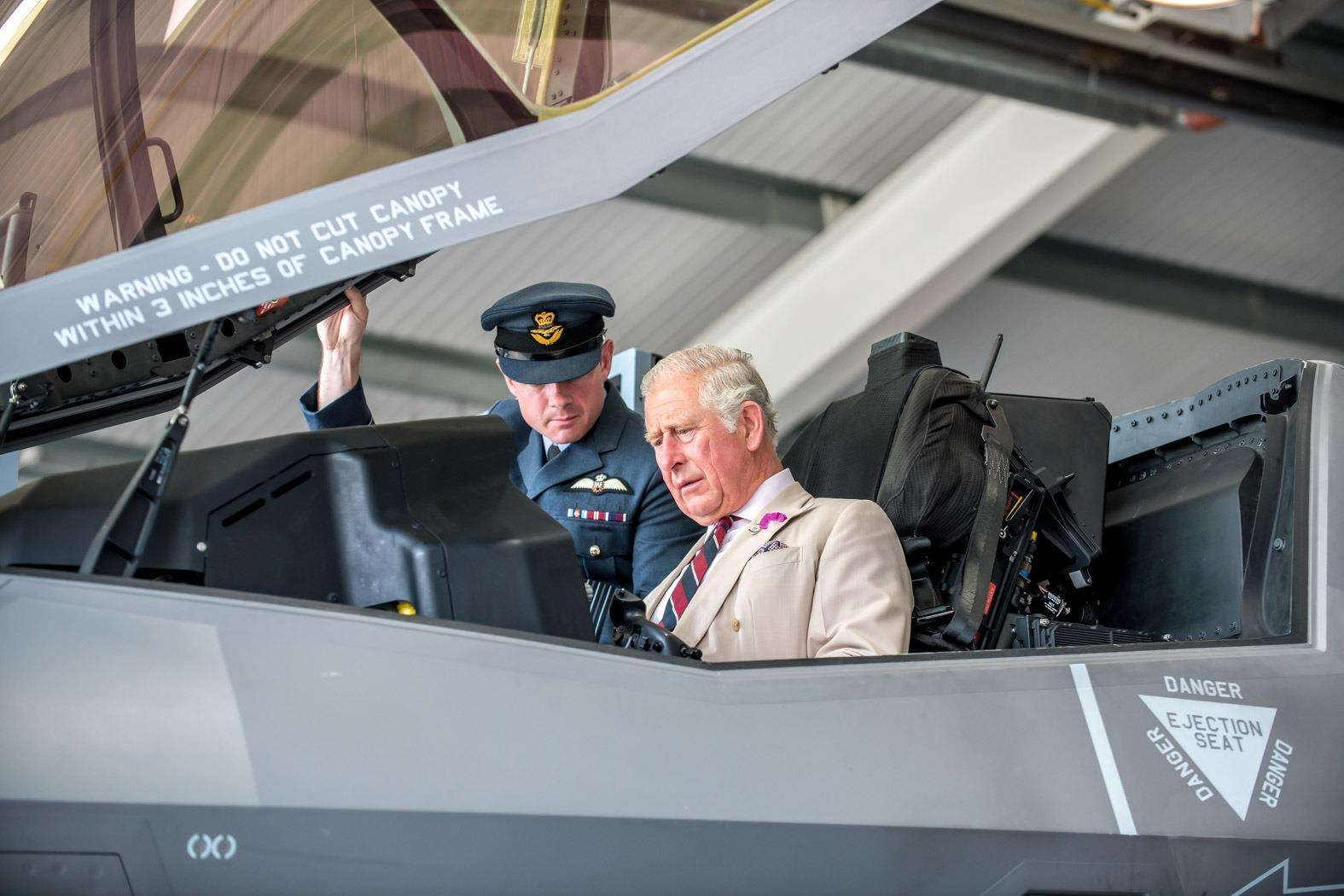 HRH The Prince of Wales visits RAF Marham to see the new F35 Lightning II aircraft of 617 Squadron. Wing Commander John Butcher shows HRH Prince Charles inside the cockpit.. (3315064)