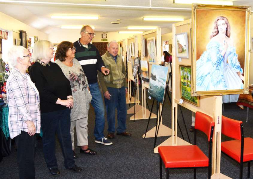 Heacham art and craft day for Norfolk Hospice'From left - Tapping House volunteer, Val Smith, and art group members Stella Langley, Julie and Geoff Symons and Charley Poole tour the exhibition