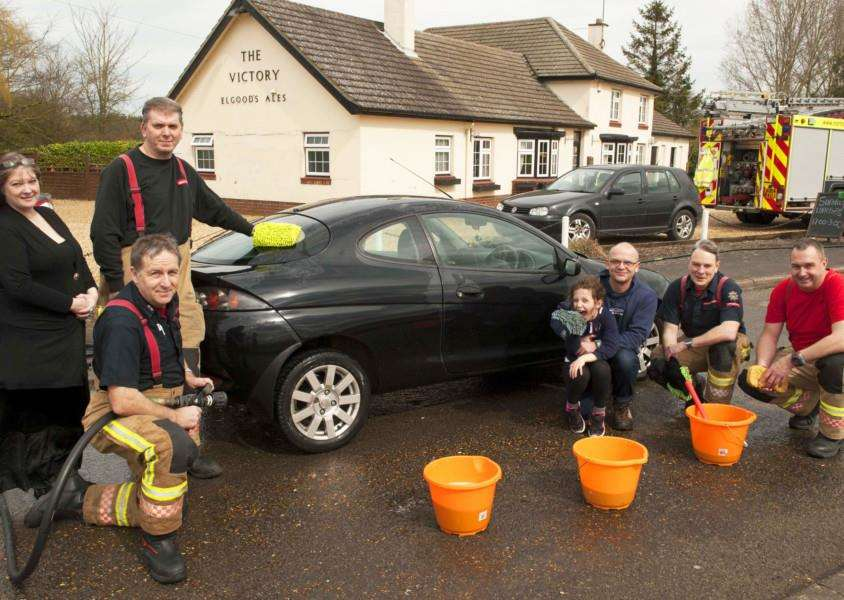 Charity Car Wash at The Victory Clenchwarton. Pictured Terrington Fireman raising funds for charity.