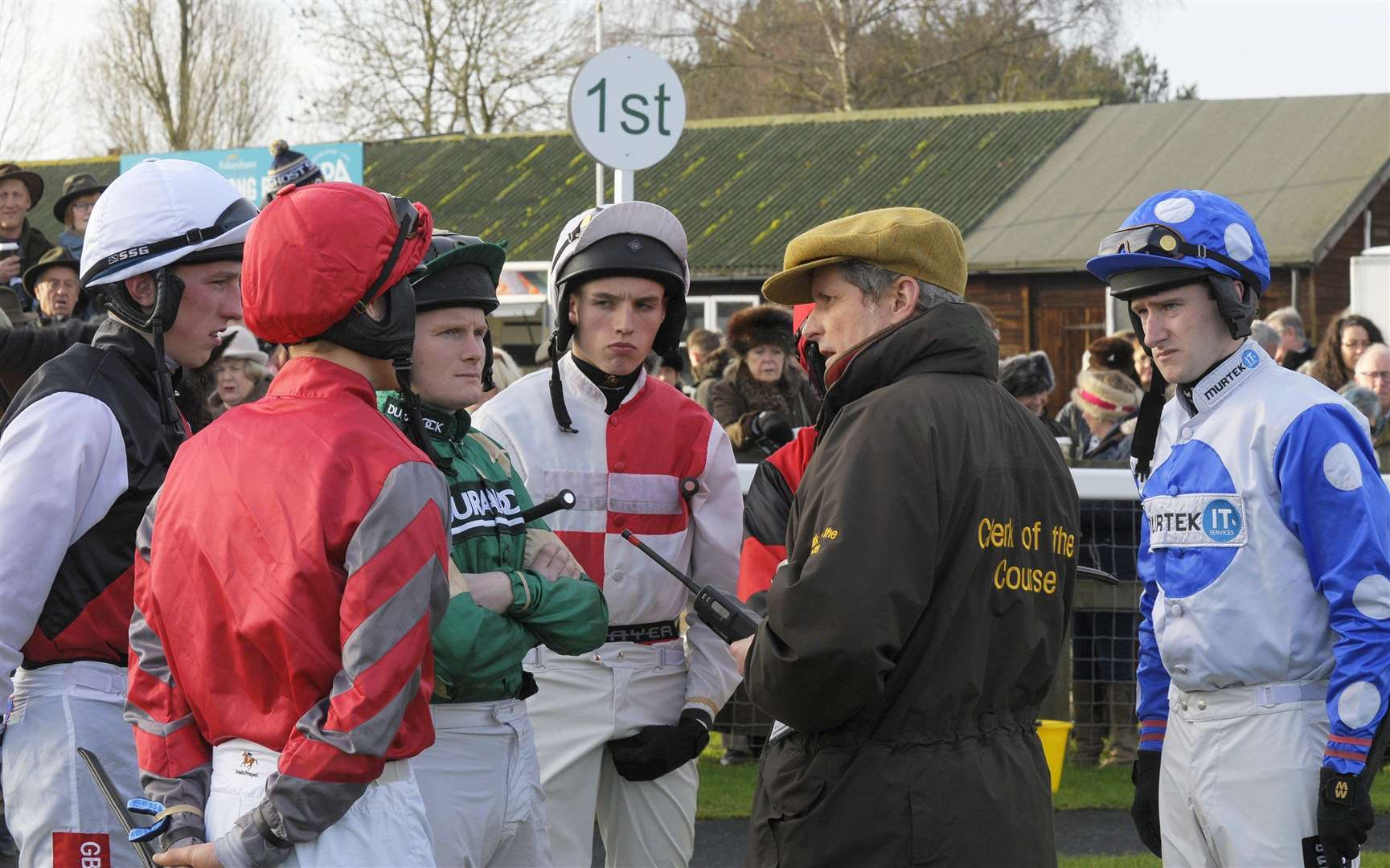 Fakenham Racecourse chief executive David Hunter, seen here with jockeys at an earlier fixture, is awaiting news of whether the track can host its planned meeting next week
