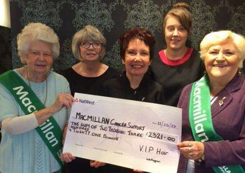 VIP Hair's Linda Pepper with staff members present a cheque for �2,321 to representatives from Macmillan Cancer Support from funds raised at World's Biggest Coffee Morning in September