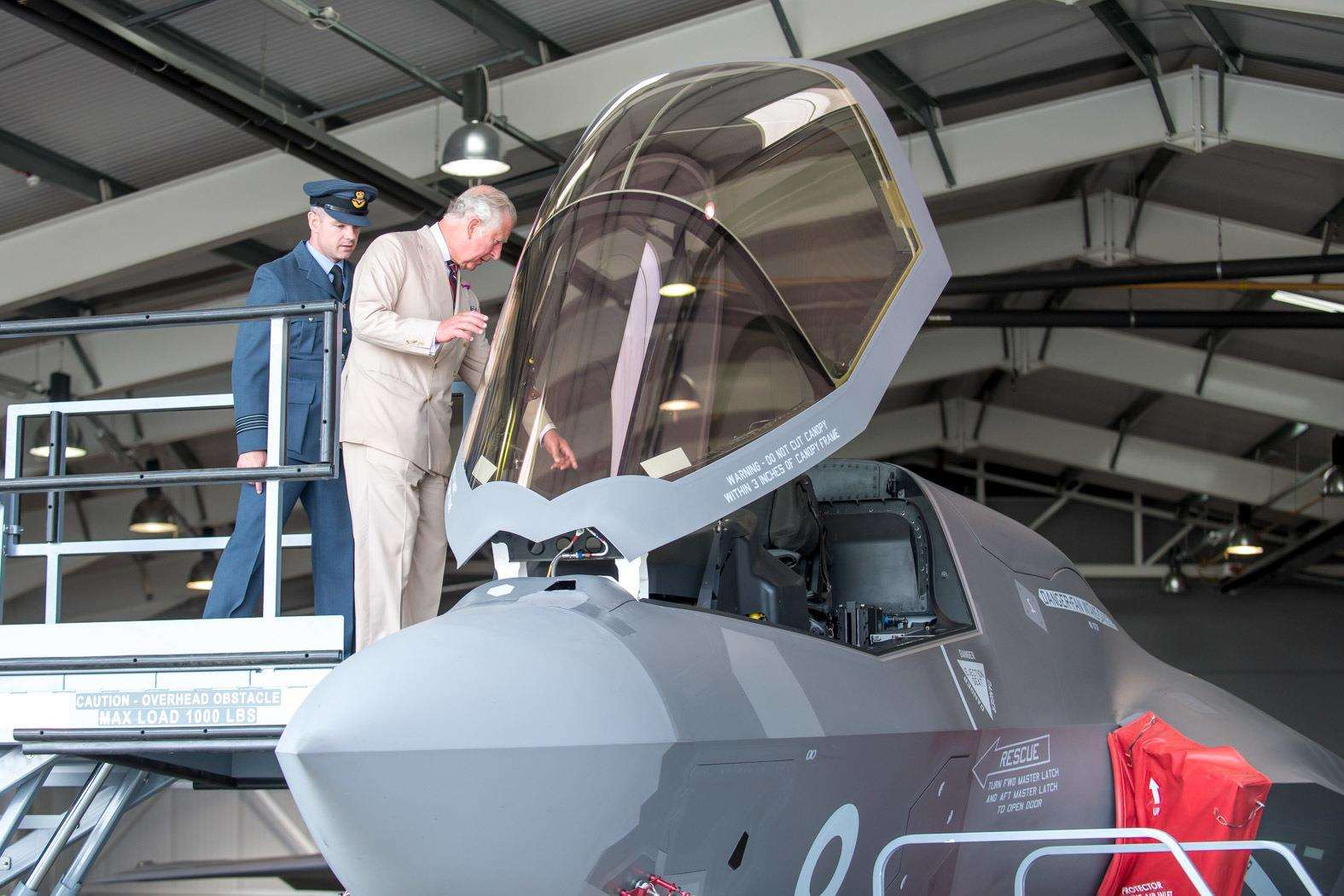 HRH The Prince of Wales visits RAF Marham to see the new F35 Lightning II aircraft of 617 Squadron. Wing Commander John Butcher shows HRH Prince Charles inside the cockpit.. (3315056)