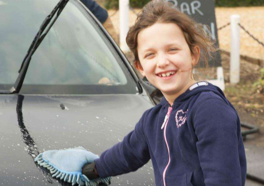 Charity Car Wash at The Victory Clenchwarton. Pictured Sophie Mcleod. with the Terrington Fireman