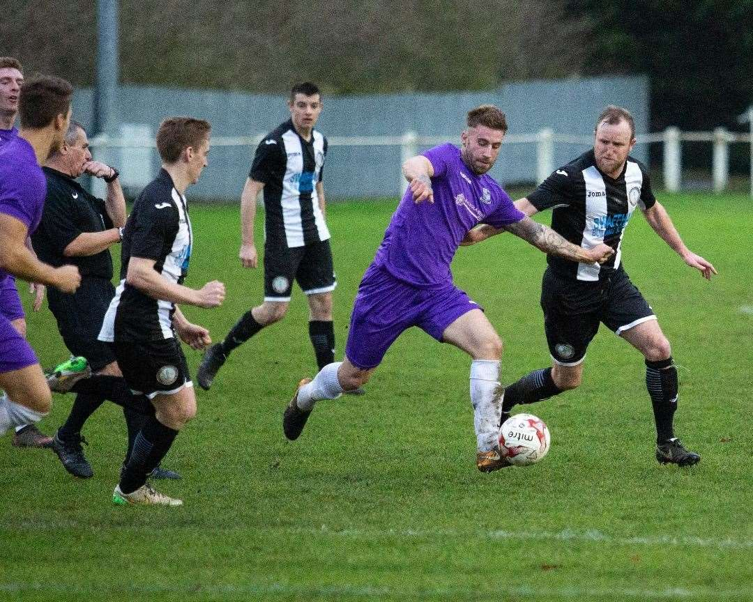 Dean Miller attempting to contain the Long Melford defence. Picture: Eddie Deane. (22456557)